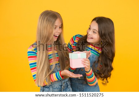 So touched with gift. Thank you so much. Child giving gift box to friend. Kid girl delighted gift. Girls celebrate birthday. Shopping and holidays. Kid happy loves birthday gifts. Dreams come true. #1511520275