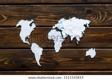 Planning a travel concept. Sketchy map of the world on dark wooden background top view #1511543819