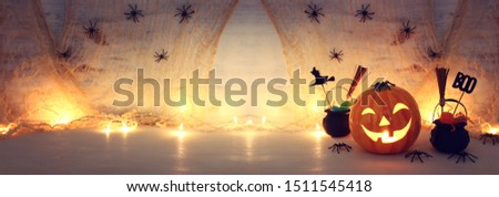 holidays halloween concept image. Pumpkin, spiders over wooden table #1511545418