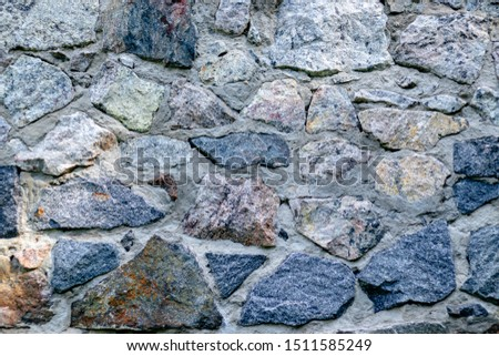 Fragment of a wall from a chipped stone for background #1511585249