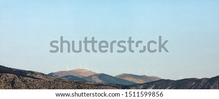 Wind turbines for ecological power in mountaing in Greece. windmill #1511599856
