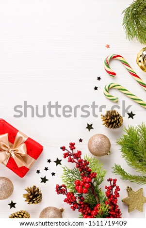Christmas frame red flat lay with presents, golden elements, candy canes, confetti. Christmas template on white wood #1511719409