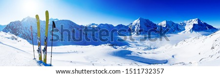 Ski in winter season, mountains and ski touring backcountry equipments on the top of snowy mountains in sunny day. South Tirol, Solda in Italy. #1511732357