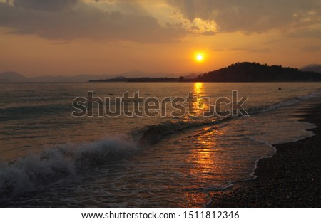 Sunset on the Calis Beach on the Aegean Sea #1511812346