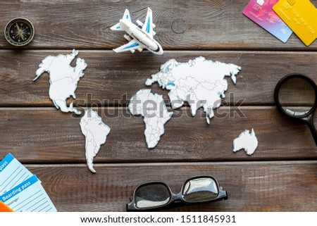 Planning a travel concept. Sketchy map of the world on dark wooden background top view #1511845931