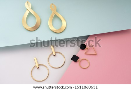 Golden modern stud geometric earrings on colorful background #1511860631