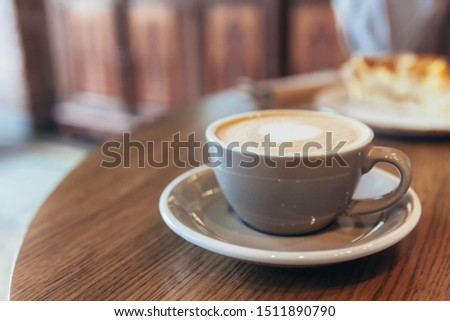 Coffee cup fresh cream organic cappuccino on table in cafe.  #1511890790