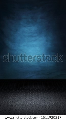 Dark blue backdrop with metallic floor ready for a product packshot or model photoshoot