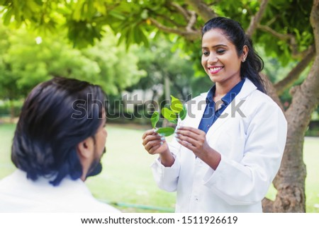 Indian female scientist having a speech on a botany / biology practical class outdoors #1511926619