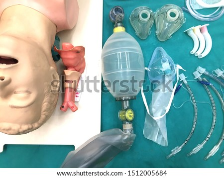 Medical equipment for airway management : model, nasopharyngeal airway, oral airway, mask with bag and endotracheal tube on table Royalty-Free Stock Photo #1512005684