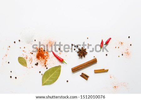 set of assorted colorful spices on a white background, flat lay, top view, with copy spice #1512010076