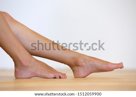 Woman bare feet on the floor. Legs care and skin treatment concept. #1512059900