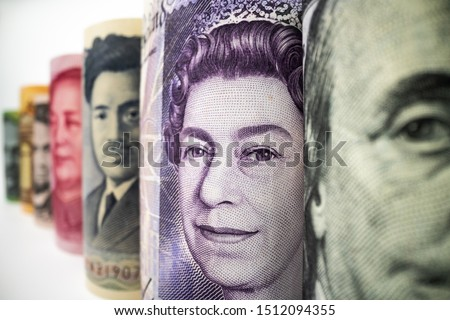 Macro shot of international currency money include US American Dollar, Euro Currency, British UK Pound, Australian Dollar, China Yuan and Japan Yen. Foreign currency money exchange and Forex concept. #1512094355