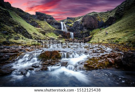 Wonderful nature of Iceland. fresh green grass and icelandic moss near river with waterfall. Typical Icelandic scenery during sunset.  Picture of wild area. Dramatic Scene with colorful sky #1512125438