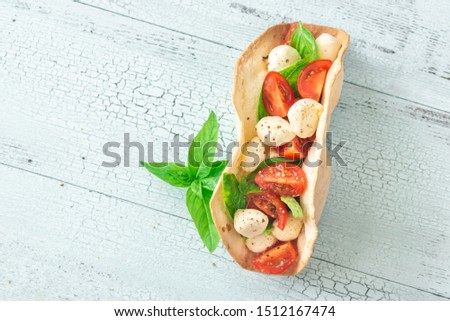 Caprese taco on the wooden table #1512167474