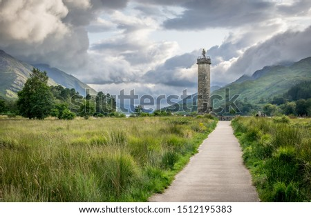 a view of Glenfinnan Monument in a valley. #1512195383
