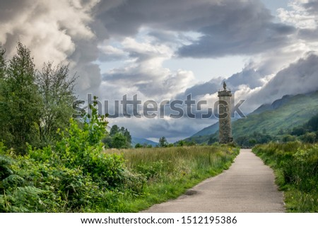 a view of Glenfinnan Monument in a valley. #1512195386