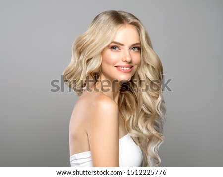 Beautiful blonde hair woman long curly hairstyle healthy skin natural makeup #1512225776