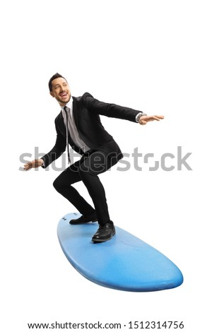Full length shot of a young businessman standing on a surfing board isolated on white background #1512314756