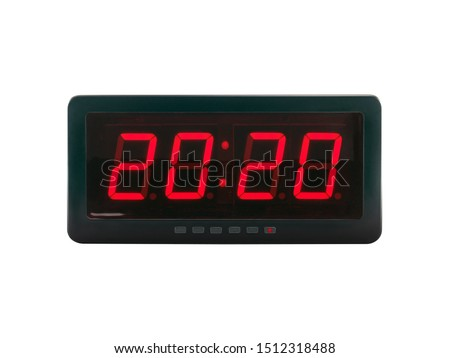 close up red led light illumination numbers 2020 on black digital electric alarm clock face isolated on white background, time symbol concept for celebrating the New Year #1512318488