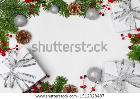 Christmas background with balls and decorations of holly berry, cones, gifts, balls on white #1512328487