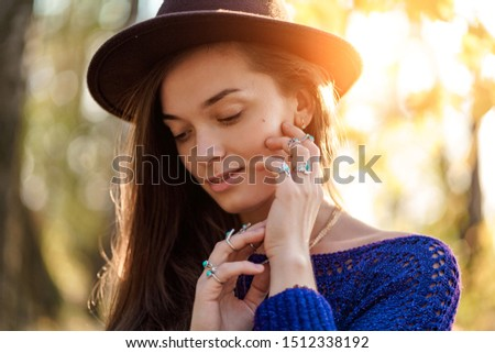 Portrait of sensual attractive boho chic woman in brown hat and knitted sweater wearing necklace and silver rings with turquoise stone. Stylish fashionable jewelry girl with boho fashion #1512338192