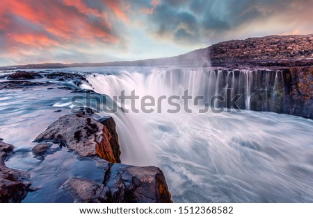 Awesome landscape in Iceland with colorful sky. Selfoss waterfall. Gorgeous summer sunset in Jokulsargljufur National Park, Famous Tourist Attraction. Iconic location for landscape photographers