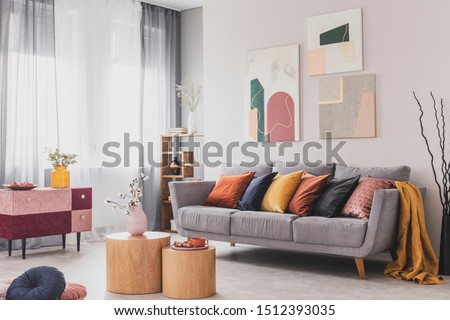 Coffee table in front of grey couch in scandinavian living room #1512393035