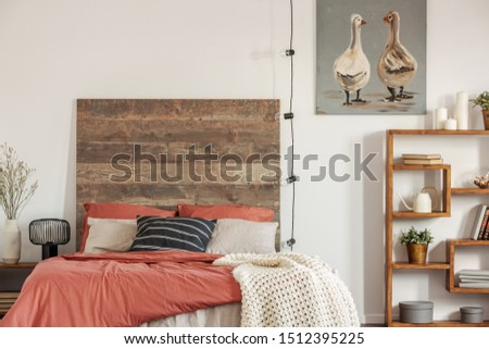 Cozy bedroom interior with king size bed with dirty range bedding and white blanket #1512395225