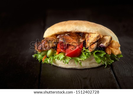 close up of kebab sandwich on wooden background #1512402728