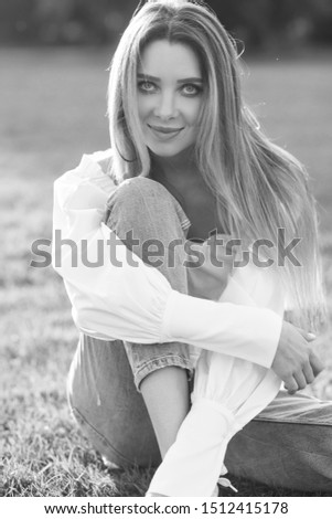 Young pretty woman natural outdoor portrait. Young pretty woman natural outdoor portrait. Beautiful girl sitting at grass at sunset #1512415178