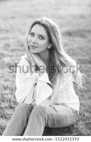Young pretty woman natural outdoor portrait. Young pretty woman natural outdoor portrait. Beautiful girl sitting at grass at sunset #1512415193