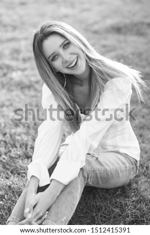 Young pretty woman natural outdoor portrait. Young pretty woman natural outdoor portrait. Beautiful girl sitting at grass at sunset #1512415391