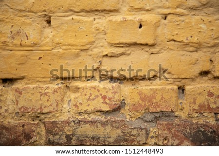 old yellow brick wall texture background close up. free space for text. wallpaper for your device. #1512448493