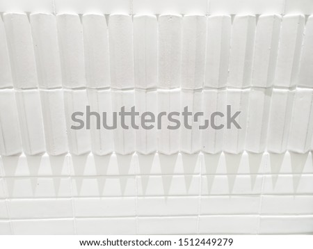 Vertical rectangles reliefwhite cement wall, when the light is change diection make it more interseting shape. #1512449279