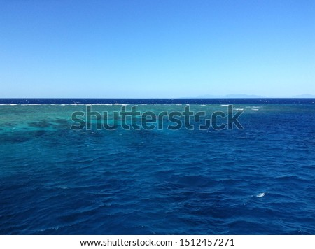 Coral reef in the great barrier reef, visible by coloration of the water, reefs are often bleached #1512457271