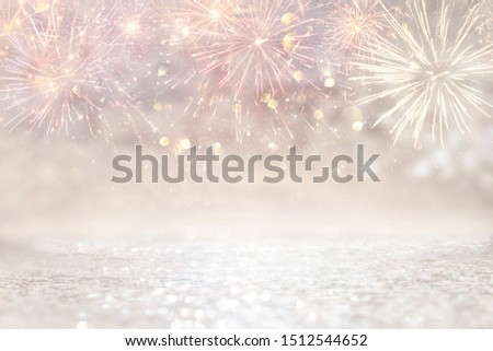 abstract gold and silver glitter background with fireworks. christmas eve, 4th of july holiday concept #1512544652