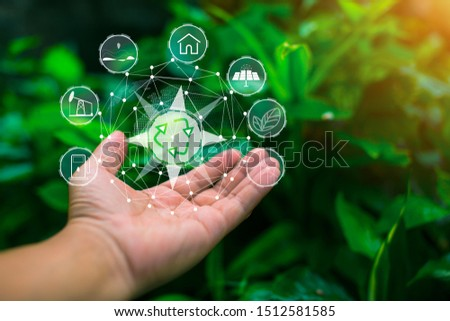 Technology, hand holding with environment Icons over the Network connection on green background. #1512581585