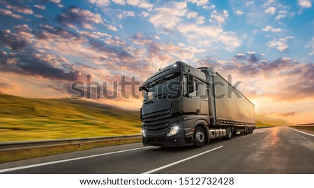 Truck with container on highway, cargo transportation concept. Shaving effect. #1512732428