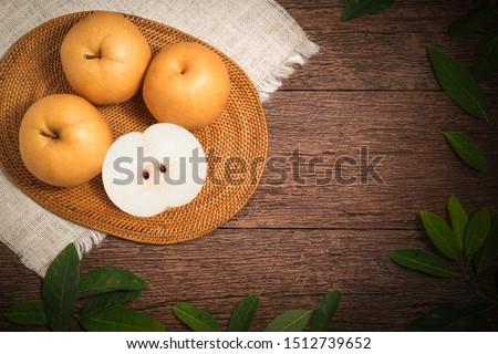 Snow pear or Korean pear on a wooden background, Nashi pear fruits delicious and sweet on wooden background #1512739652
