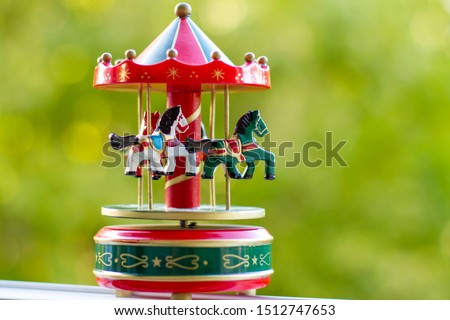 Vintage musical carousel toy in garden