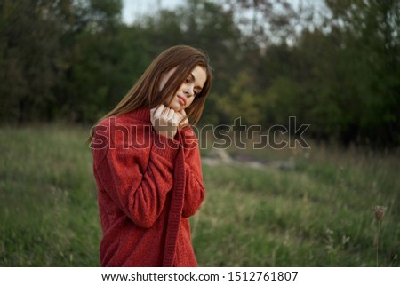 woman in red on nature stands #1512761807