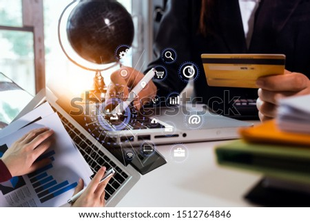 Businessman using a laptop on tablet digital interface. innovation, icon and media information on network connection, double exposure, #1512764846
