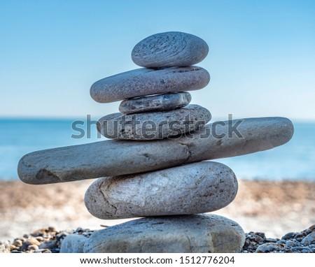stack of zen stones on pebble beach #1512776204
