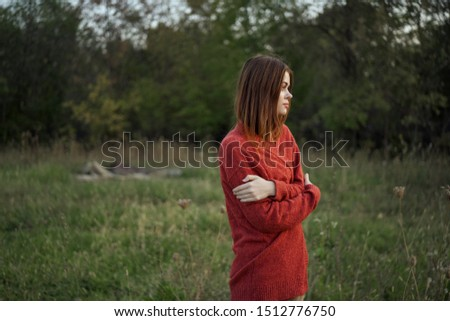woman in warm red sweater outdoors #1512776750