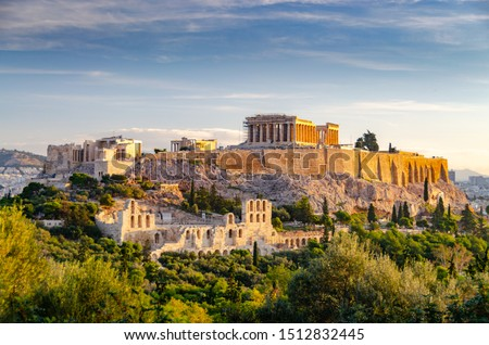 ATHENS, GREECE – NOVEMBER 4, 2018: Famous Athens landmark Acropolis and the Odeon of Herodes Atticus, Herodeion, just after the sunrise. View from Filopappou Hill with lots of olive trees and conifers #1512832445