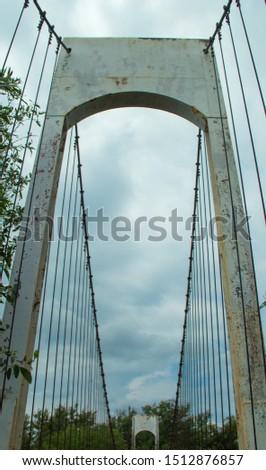 Ancient suspension bridge,Suspension bridge and blue sky. #1512876857