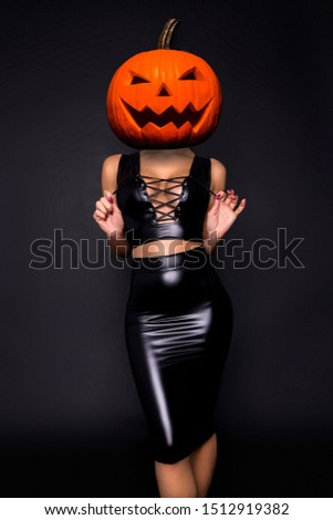Halloween sexy model with a pumpkin on her head. Beautiful young woman in sexy lingerie. Wide Halloween party design - picture