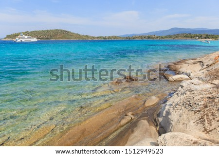 Beautiful view of summer rocky bay seascape , amazing color of sea water at the coast of Sithonia Halkidiki Greece. #1512949523