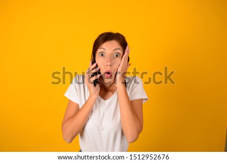 surprised woman talking on the phone #1512952676